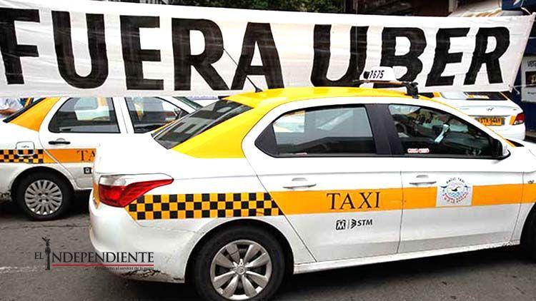 Confrontan taxistas uruguayos a Uber… registrando la marca