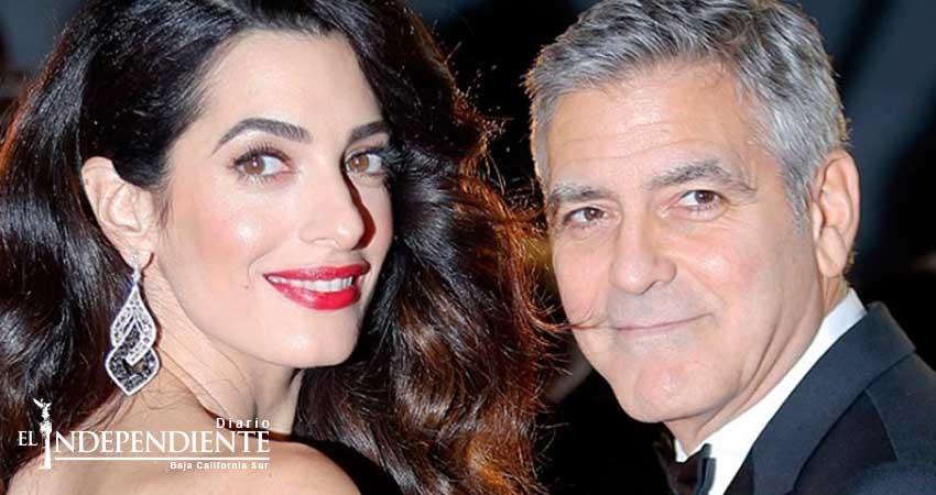 Clooney amenaza con tomar medidas por fotos de sus mellizos
