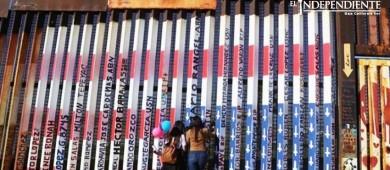 Mural en frontera con bandera de EU al revés, en la mira de autoridades